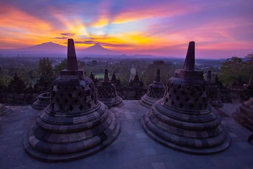 blue borobudur indonesia java yogyakarta jogjakarta sony a77 ultrawide wideangle sunrise buddhism temple ancient pink red purple merapi monument