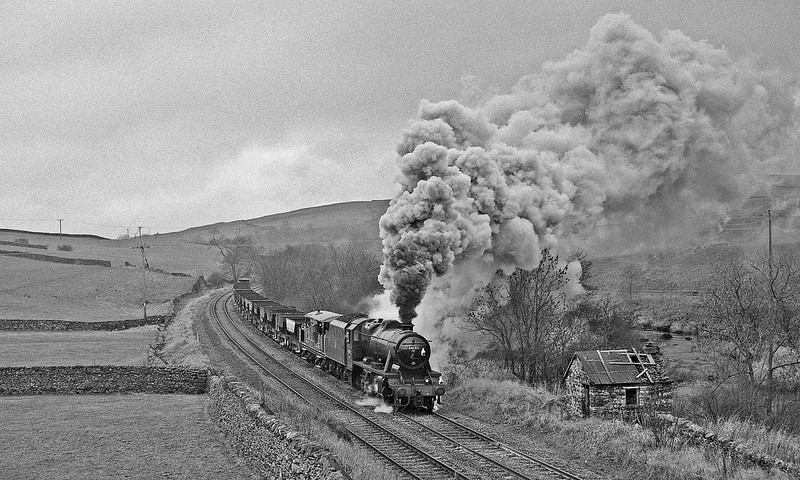 On completion of extensive track renewal on the S & C, Railtrack hired 48151 for the last ballast working of the programme. The 8F is seen here with the empty vacuum-braked Catfish hoppers en route to Ribblehead quarry to collect the final load of new ballast. To date, this has been the only 'real' steam hauled main line freight working in preservation.