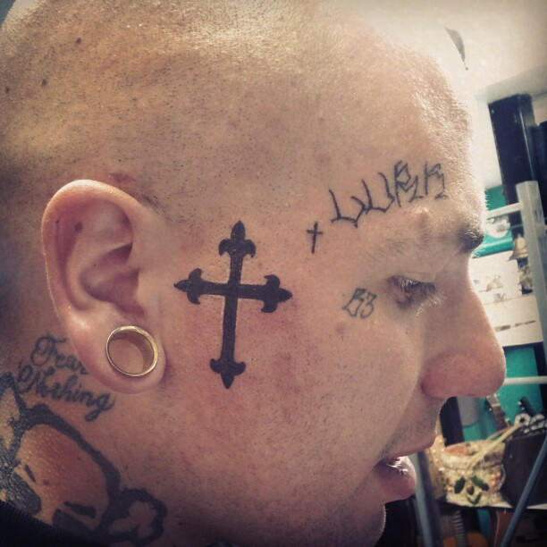 Rapper With Z Tattoed On His Face: Second Tattoo Today. Cross On Rapper @b3_the_shark Face
