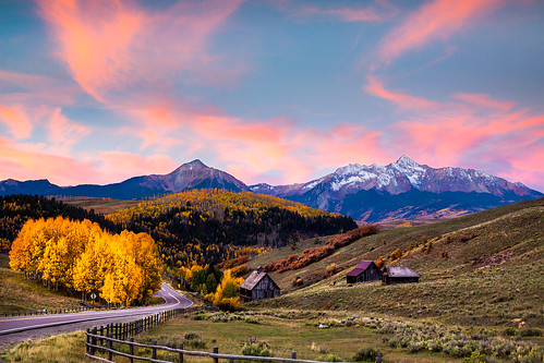 road old morning autumn trees light sky mountains color field clouds rural america sunrise fence landscape rockies dawn ruins scenery colorado day seasons unitedstates cloudy meadow icon historic aspens jagged telluride rockymountains peaks rundown sanjuanmountains manandnature leadingline coloradogold aspenlined