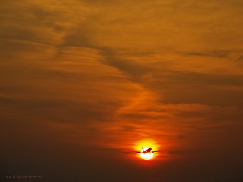 cloud sun silhouette clouds sunrise airplane dawn airport aircraft aviation airplanes sunrises airports sunbeam cloudscape sunray erj190