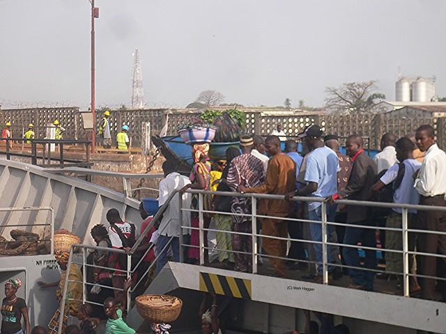 Disembarking a ferry in Freetown, Sierra Leone