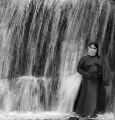 bw wet fountain girl standing israel waterfall fat braid wadiqelt judeandesert