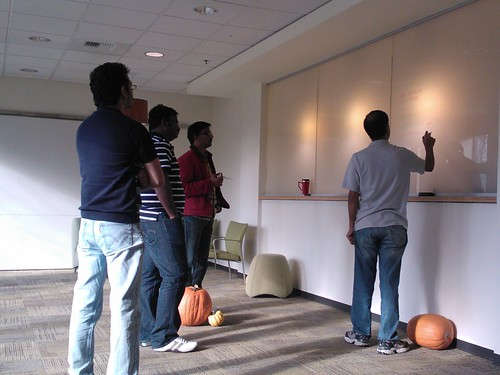 Sr program manager, pumpkins at his feet shares insights on Excel 2013, planning a new application, giving instruction on transparent lighted panels, programers, program managers, consultants, Microsoft, Redmond Town Center, Washington, USA | by Wonderlane