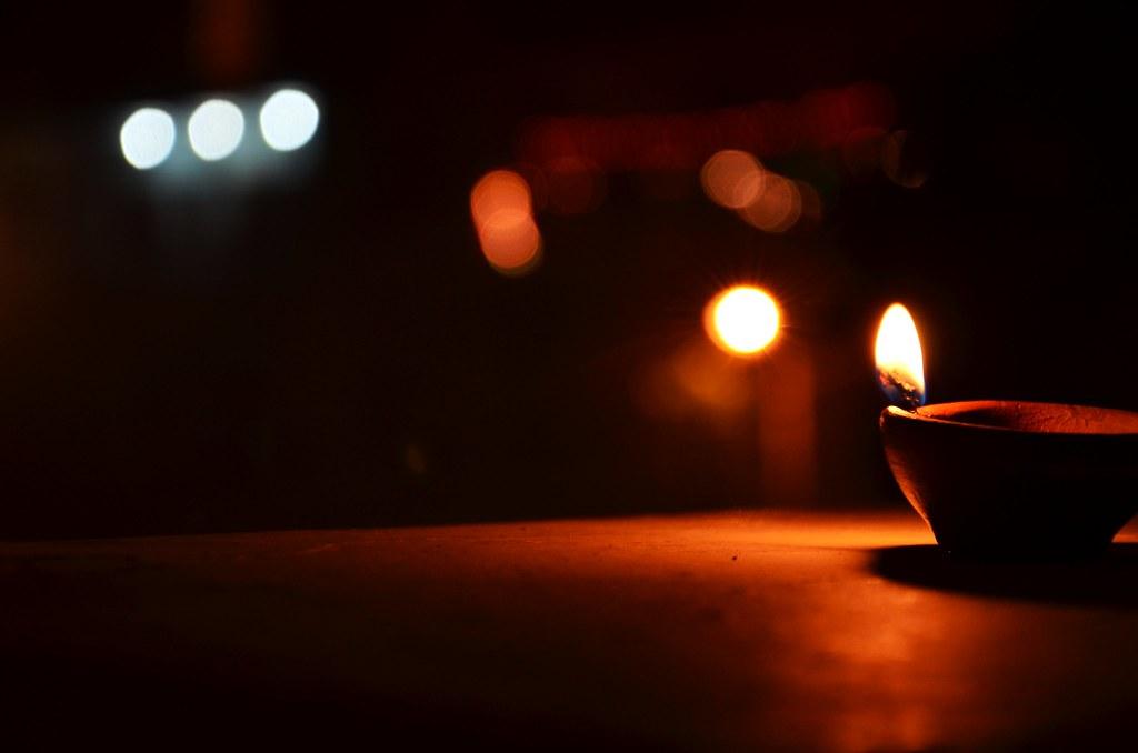 Image result for light diya on diwali,nari
