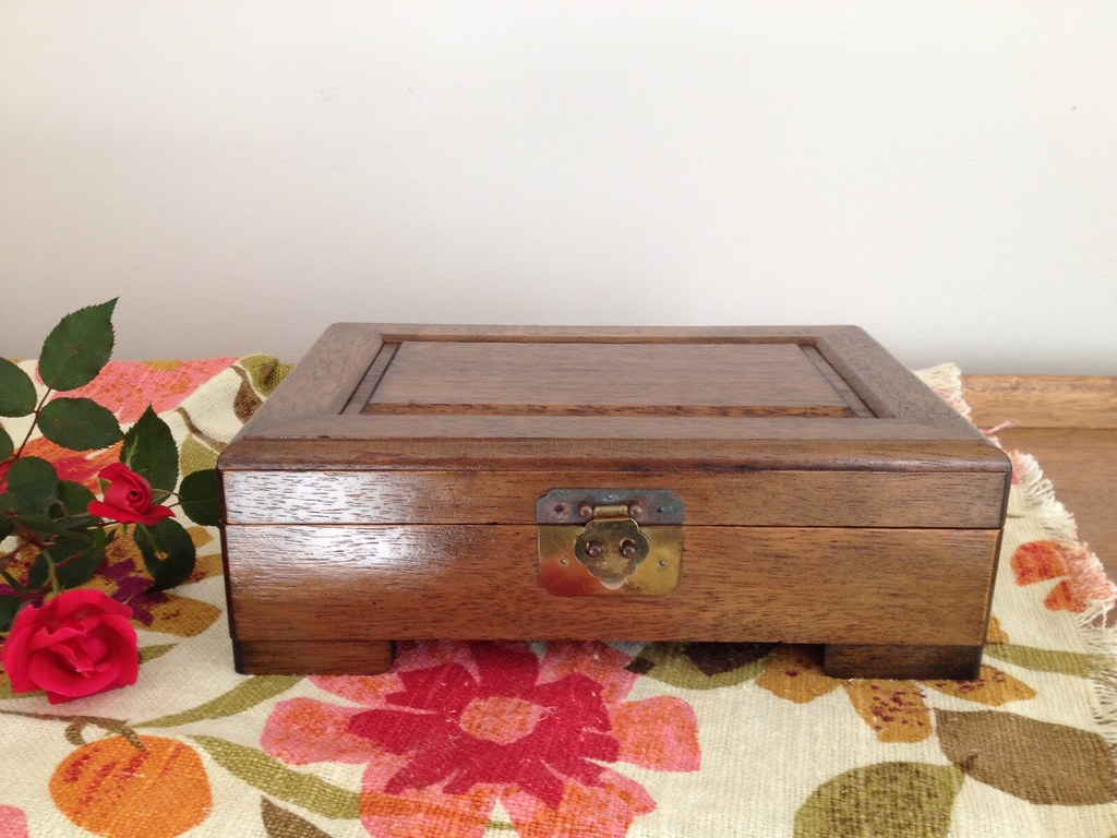 Vintage Wooden Jewelry Box on flower table cloth