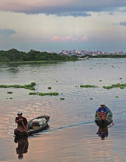 Traditional fishers in Cacau Perera, Iranduba, Brazil with Manaus in the background