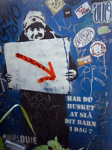 Banksy-influenced wall mural in the counter culture Christiania part of Copenhagen, Denmark