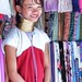 WeGoTwo posted a photo:	Another young long neck girl with her wares.  The variety of colours in the scarves provided some lovely contrasts.
