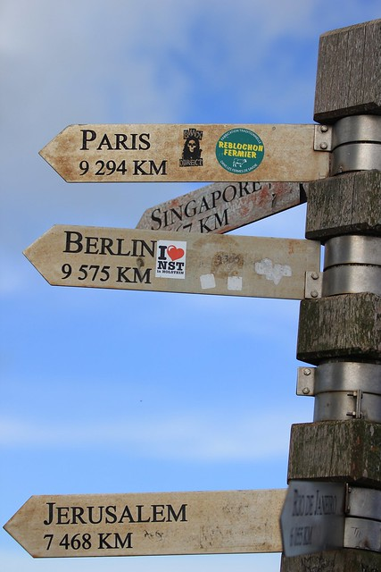 Far away - The sign at the Cape of Good Hope that shows distance from Paris, Singapore, Berlin and Jerusalem. Cape Town, South Africa, 2012.
