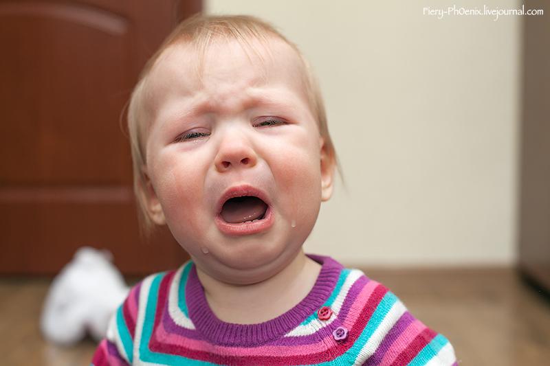 Portrait of crying baby girl
