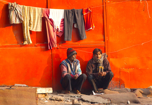 poverty morning two india color men horizontal outdoors sitting indian homeless photograph ethnic cultural newdelhi socialissue