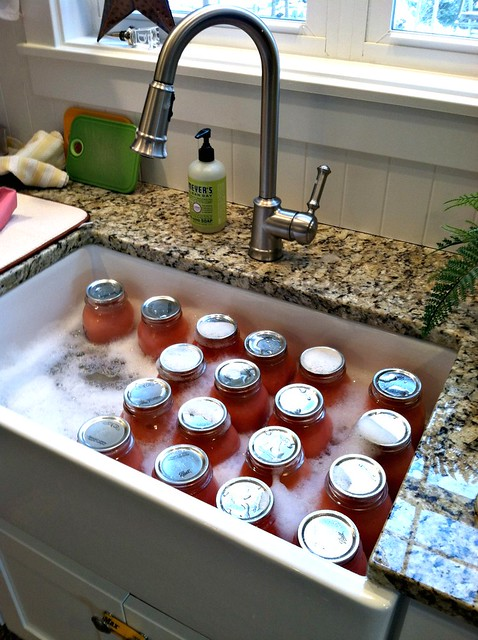 washing mason jars in the farmhouse sink in our kitchen