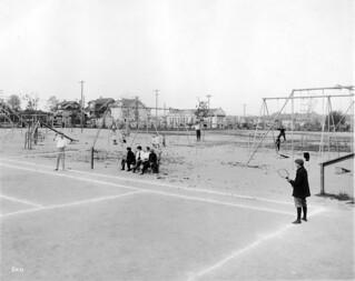 Boys playing tennis at University Playground, 1913
