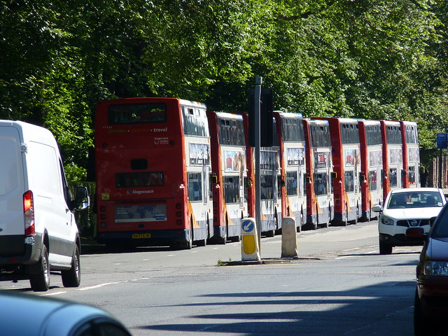 A line up of primarily ex Stagecoach London Dennis Tridents Alexander 400 at Queen Street, Edinburgh on T in the Park duty. 10 July 2014. Rear vehicle is V477KJN 17111. Buses were held here until called forward for loading at Edinburgh Bus Station.