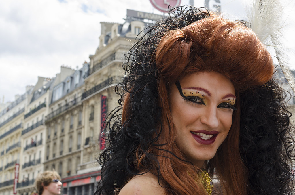 A drag queen dressed in a veil at a Pride Parade in Paris