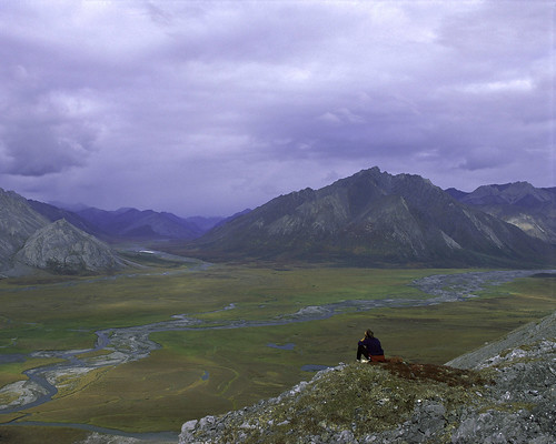 Person on rock above Arctic National Wildlife Refuge | by USFWS Headquarters