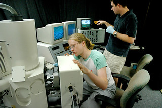 Kristina Bajema '06 and Chemistry Professor Chuck Taylor prepare to use the new field emission scanning electron microscope in 2004.
