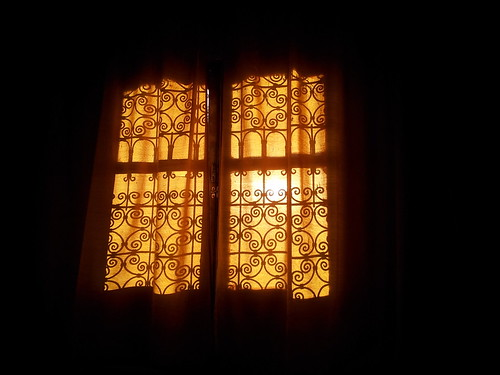 Window with yellow curtains in shadows | by g4ll4is
