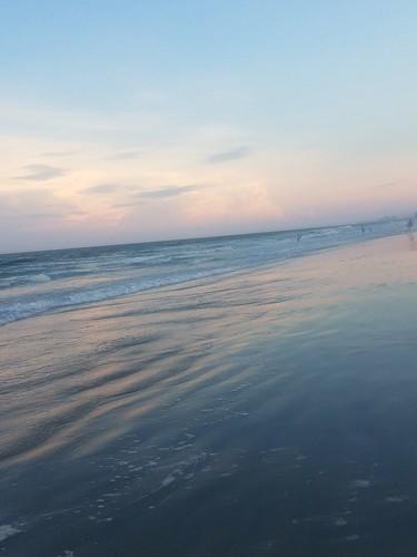 northmyrtlebeach beach sand surf waves sunset clouds sky landscape people
