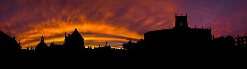 light sunset red england sky orange sun black church abbey silhouette architecture night fire flame dorset sherborne