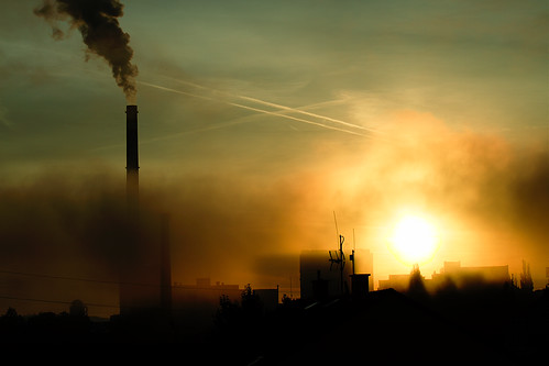 city sunrise industrial pollution