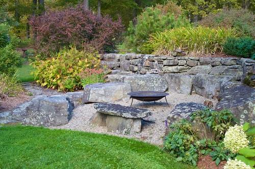 fallcolor fallcolors firepit outdoorroom outdoorsittingarea sittingarea stonewall stonework stones