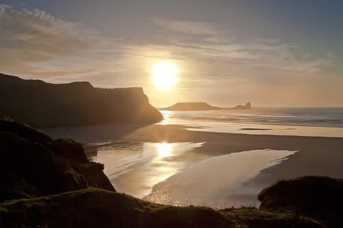 sunset sea sky sun reflections bay sand head flare gower worms hazy rhossili