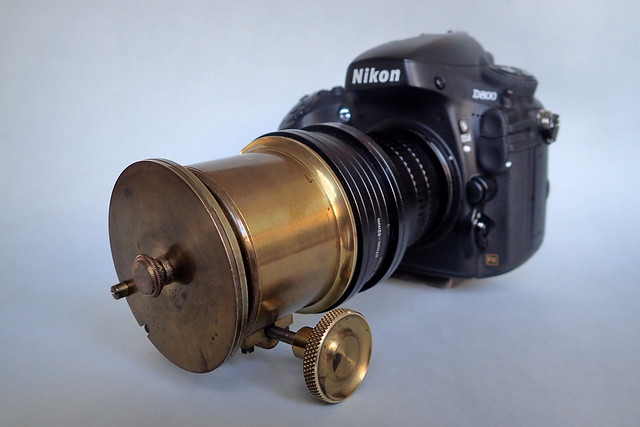Unnamed, brass-bound 5-inch projection lens in dual control brass focussing mount