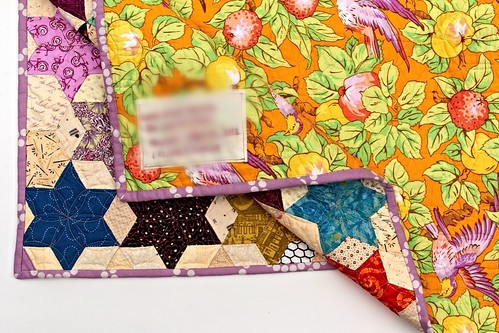 showing the back of the EPP 60 degree diamond star quilt | by Stitchliterate