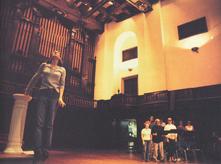 Margaret Hunter '00 and a chorus of singers rehearsing a scene from the opera Dido and Aeneas in November 1999.