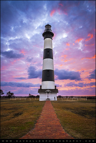 bodieislandlighthouse bodie island nc northcarolina lighthouse capehatteras obx outerbanks nagshead national eastcoast lighthouses sunrise dawn carolina daveallen nikon d700 cape hatteras nationalpark landmark sunset landscape vertical striped pink red purple beacon ocean atlantic atlanticcoast easternnc vacation beach carolinas coastal coast colorful dramaticsky beautiful paradise photography scenic sky travel mygearandmediamond reallyrightstuff nikond800 outdoorphotographer bodieisland leadinglines
