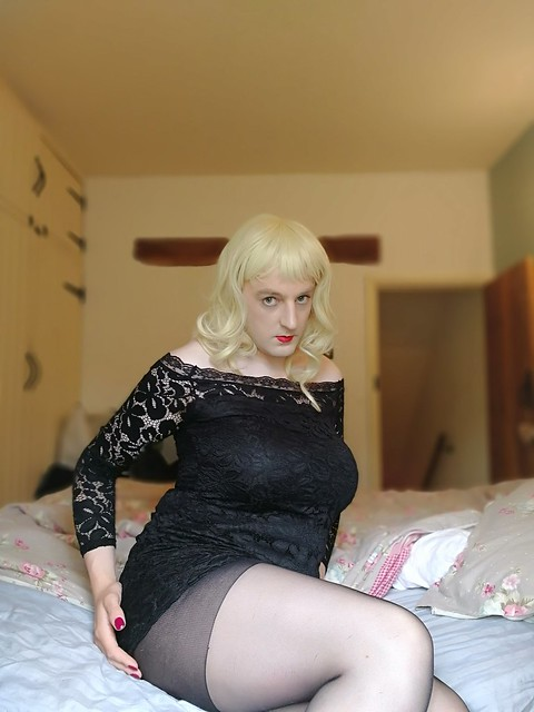 Wearing a new lacey black dress.
