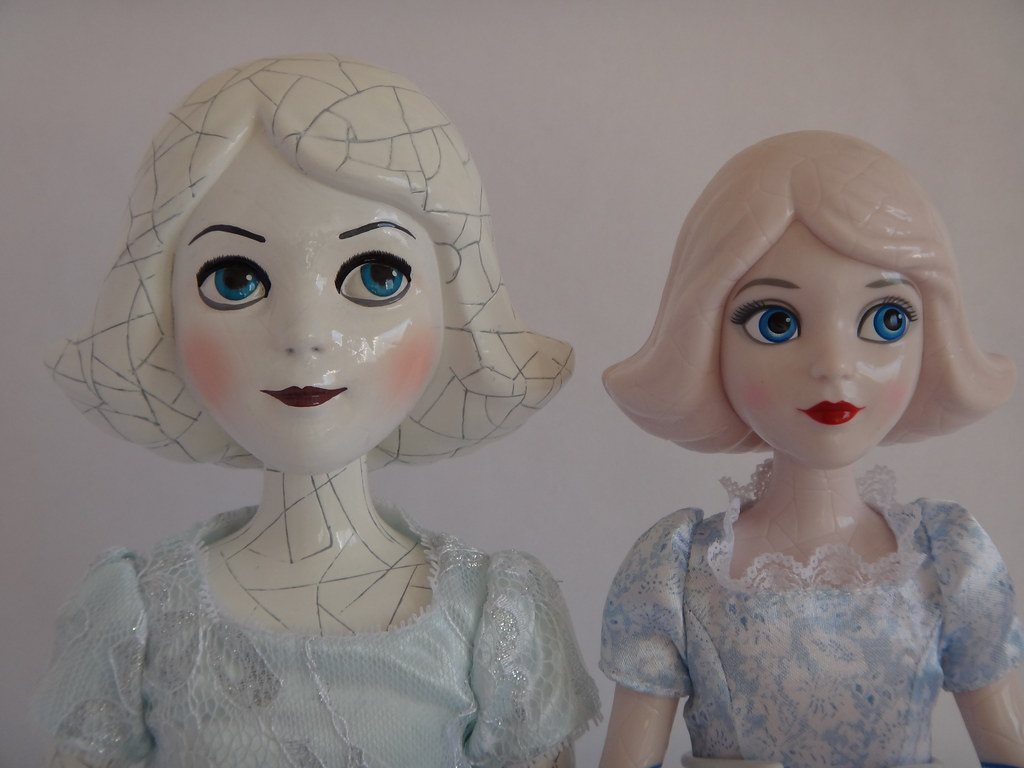 Comparing China Girl Dolls - Disney Store vs Tollytots - Oz The Great and Powerfull - On Display Stands - Portrait Front View