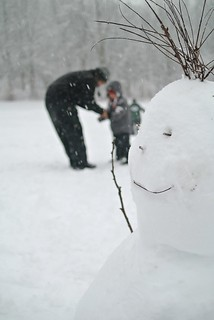 Father, son, wacky-haired snowman