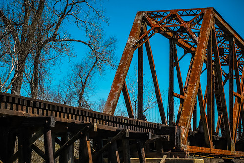 wood railroad bridge blue sky usa brown metal ties landscape photography march countryside us photo iron texas photographer unitedstates image tx unitedstatesofamerica tracks tie bluesky 100mm photograph rails 100 february f56 clearsky trusses truss fav10 onthetracks 2013 wallercounty railsroad ¹⁄₁₀₀₀sec eos5dmarkiii ef100mmf28lmacroisusm mabrycampbell march32013 sealybridgebridge 201303030h6a0790