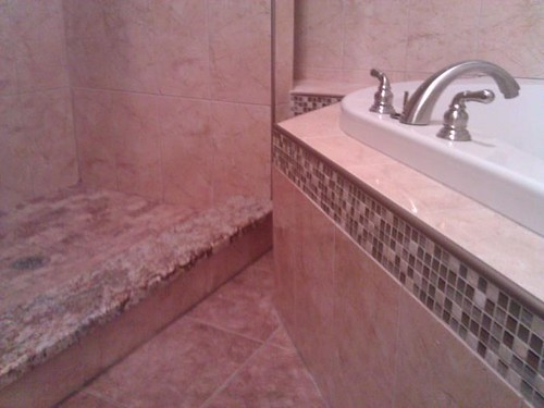 Travertine tile with glass border accents