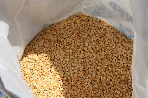 A sack of split peas awaits distribution at a joint WFP/ACTED site in central Bamako, Mali | by DFID - UK Department for International Development