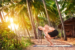 Yoga twisted pose (Pasasana) by HAWAH on the beach near the fishermen hut in Varkala, Kerala, India. | by everlutionary