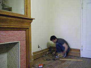 Hammering down floor boards   by Preetha & James
