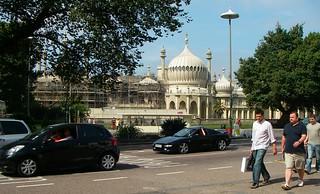 Street view of Brighton Pavilion, renovation, commuters, cars, trees, lamp, Brighton, England, UK