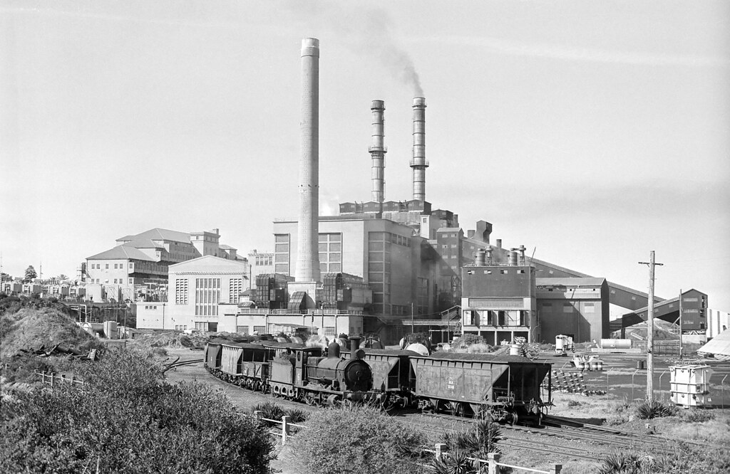 No 6 runs past Bunnerong Power Station with wagons of ash, Botany Freight Line, Matraville, NSW, circa 1973.