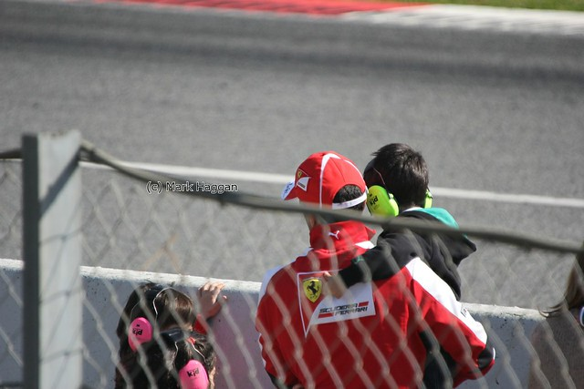 Ferrari driver Marc Gene with his children at Formula One Winter Testing 2013