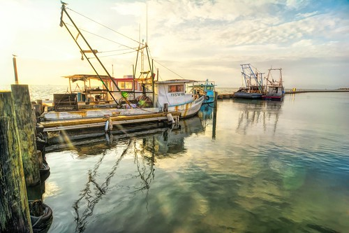 texas fultonharbor water dawn sunrise pier oysterboat commercialfisherman reflection southernstyle south fishing sky