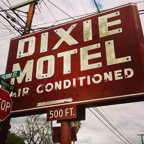 """""""Air conditioned"""" -- a key selling point in Texas! Dixie Motel's vintage neon sign. In Brenham, Texas. 