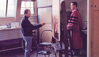 Former Pomona College President Peter Stanley posing for a painted portrait by artist Ronald Sherr in 2004