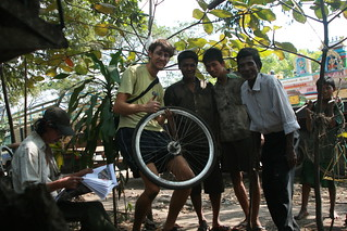 Myanmar, Yangon -  Feb 2013 - Replacing a sealed cassete bearing on my rear wheel.  I had bought a 6000 RS bearing in Bangkok, but it turns out I needed the slightly larger 6001 RS.  These friendly mechanics not only helped me take out the old bearing, bu