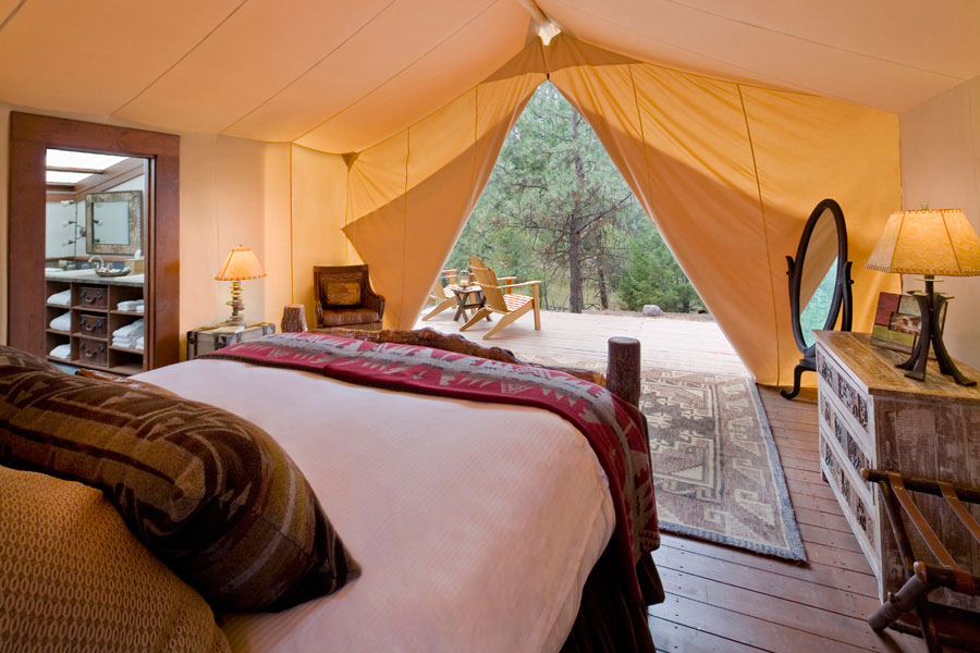 Typical of a great glamping tent, faces directly to the wildness outside, it constructed out of canvas and is furnished with comfortable furniture