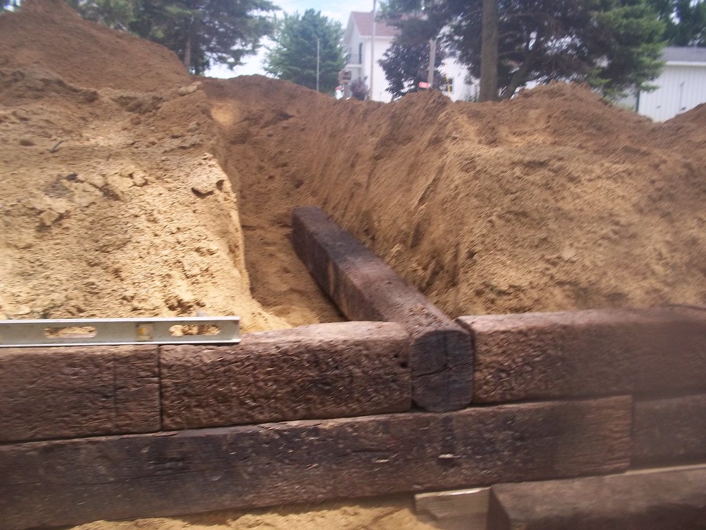 Railroad tie retaining wall | Some of the ties are buried ba… | Flickr