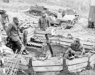The Royal 22nd Regiment mortar platoon ready to fire... Private Daniel Primeau, Private Raymond Romeo, and Private Julien Blondin...  / Le peloton de mortiers du 22e Royal Régiment est prêt à tirer... Daniel Primeau, Raymond Romeo et Julien Blondin..
